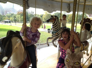 2 epilepsy warriors sharing a carousel ride after participating in a protest for cannabis access.