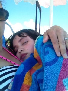 Holding her in my lap after a seizure at the beach. Just being her Mom.